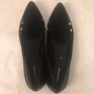 Calvin Klein flat shoe with silver stud  side.